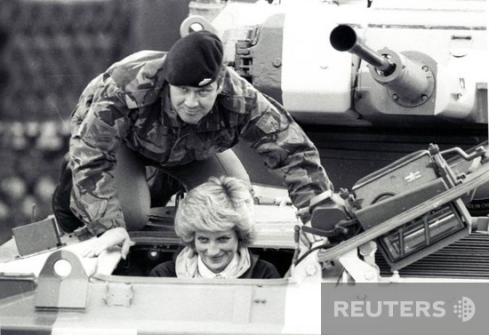 Princess Diana (L), sits in an armoured Fighting Vehicle on a visit to Wavell Barracks, the base of the Royal Hampshire Regiment, in Berlin on October 19, 1985. Colour Sargeant Jones is seen showing the Princess the controls before she drove the vehicle. REUTERS/Ulli Michel