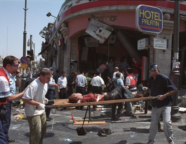 An injured girl is evacuated from the scene of a Palestinian suicide bombing at the Sbarro restaurant in Jerusalem August 9, 2001.Photo by Flash90