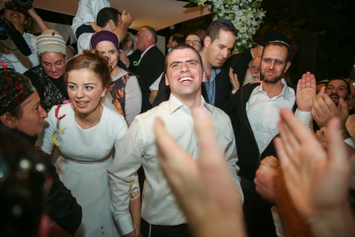 Friends and family attend the wedding of Sarah Litman and Ariel Beigel at the Jerusalem International Convention Center, November 26, 2015. Father and brother of Sarah Litman where murdered by an Arab terrorists on November 14, 2015, as they made their way to the pre-wedding Shabbat Chatan celebration. Photo by Hadas Parush/Flash90 *** Local Caption *** ????? ????? ???? ?????? ????? ???? ????? ????? ???? ????