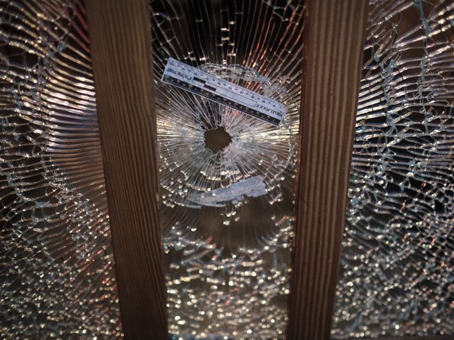 A gun shot hole in a glass window at the scene of a shooting attack at a pub in central Tel Aviv, on Friday, January 1, 2016. Two people were killed in the shootings and several injured. Police suspect a terror attack. Photo by Tomer Neuberg/Flash90 *** Local Caption *** ?? ???? ????? ??? ?????? ?????? ????? ?????? ????? ????? ?????? ???? ???? ????